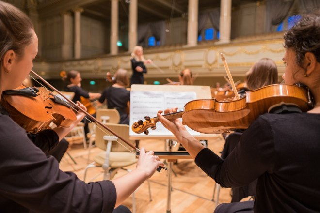 Classical musicians playing stringed instruments on stage, Gateway to Hearing Health, Gateway Biotechnology, Gateway Hearing, Gateway Hearing Blog, EarGuard, hearing loss